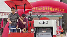 岳阳县:谁说村里不网购 一买就买个大型收割机